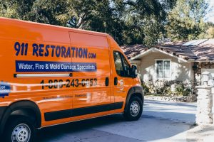 disaster restoration vehicle parked outside of residence