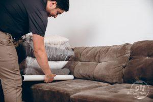 restoration technician packing up furniture